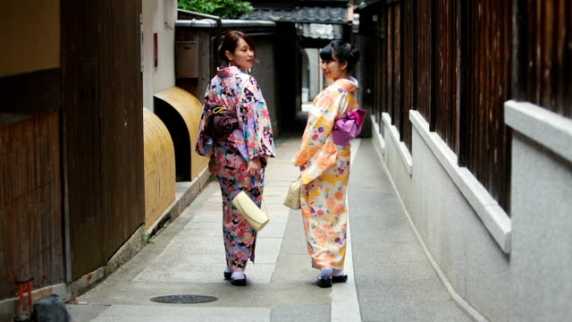 young japanese women wearing traditional kimonos - gion stock videos and b-roll footage