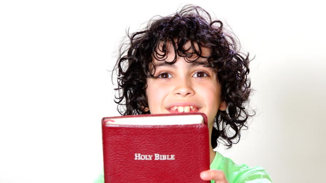 young joyful child recommending the bible - bible stock videos & royalty-free footage