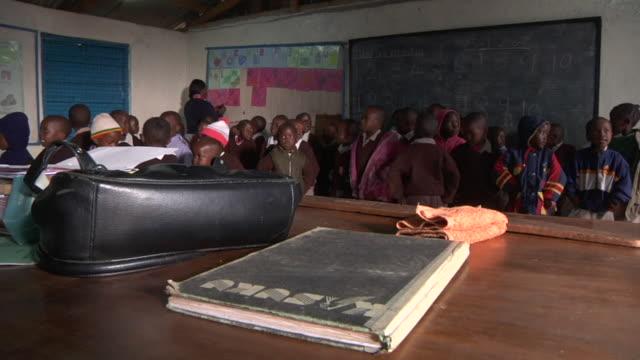 young kenyan school children sing in a classroom shot in high definition - kenia stock-videos und b-roll-filmmaterial