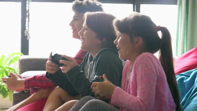 ms young kids playing a video game together. - three people stock videos & royalty-free footage