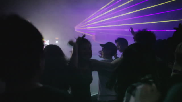 ws young koreans dance while a dj spins at a trendy nightclub in central seoul / seoul, south korea - nightclub stock videos & royalty-free footage