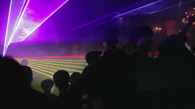 ws young koreans dance while a dj spins at a trendy nightclub in central seoul / seoul, south korea - south korea stock videos & royalty-free footage
