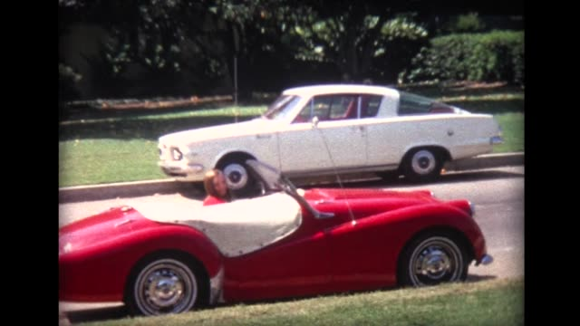 1969 young lady arrives in red convertible sports car - red convertible stock videos & royalty-free footage