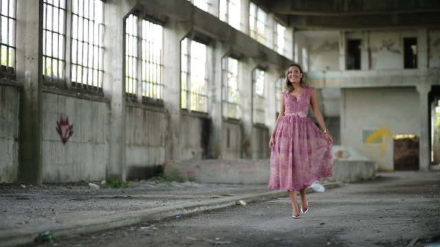 young lady in pink dress in abandoned warehouse - fashion show stock videos & royalty-free footage