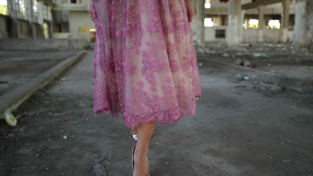 young lady in pink dress in abandoned warehouse - scarpe video stock e b–roll