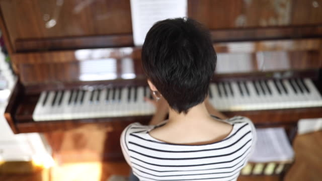 young lady pianist playing piano at home - piano stock videos & royalty-free footage