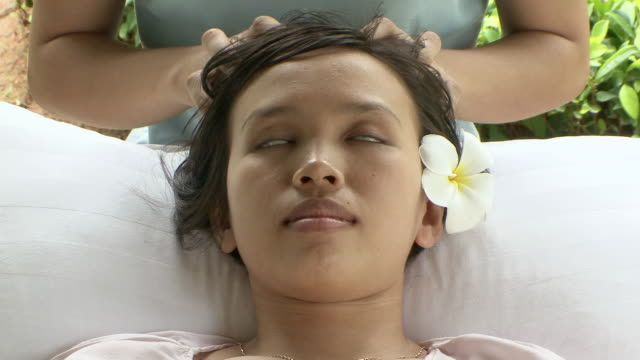 ms young lady receiving massage at luxury spa / sihanoukville, cambodia - head massage stock videos and b-roll footage