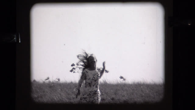 1968 young lady runs toward camera, experimental - bianco e nero video stock e b–roll