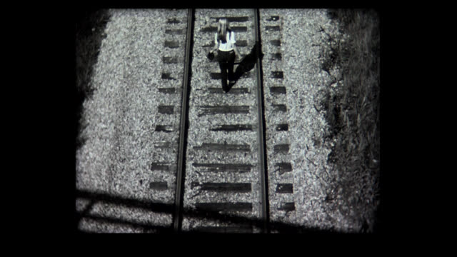 1968 young lady walks away on train track - sulking stock videos & royalty-free footage