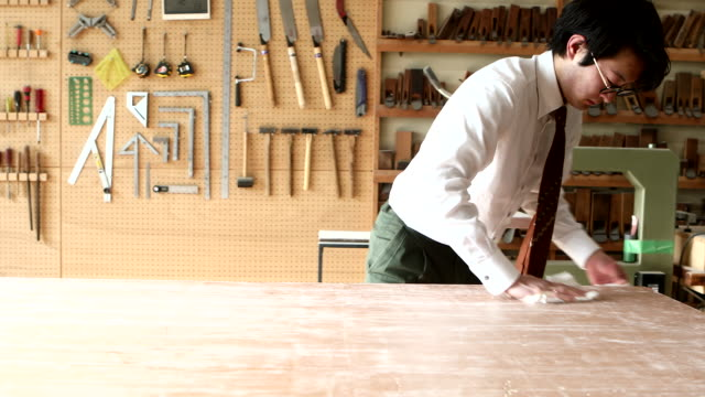 young leather craftsman cleaning workbench - shirt and tie stock videos & royalty-free footage
