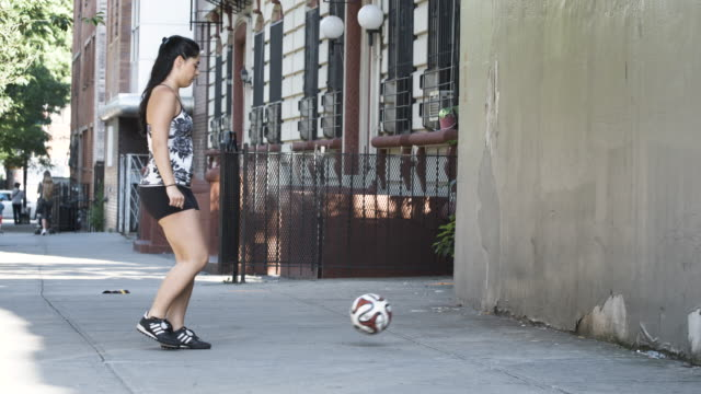 a young lebanese woman plays soccer in the streets of brooklyn, new york city - slow motion - summer 2016 - 4k - lebanese ethnicity stock videos and b-roll footage