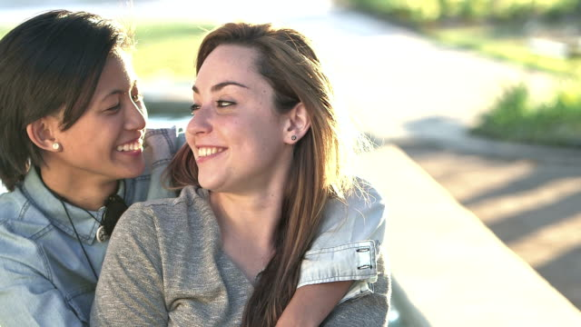 young lesbian couple embracing, talking, smiling - human rights stock videos and b-roll footage