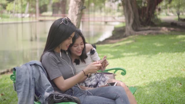 young lesbian couple embracing, talking, smiling - minoranza video stock e b–roll