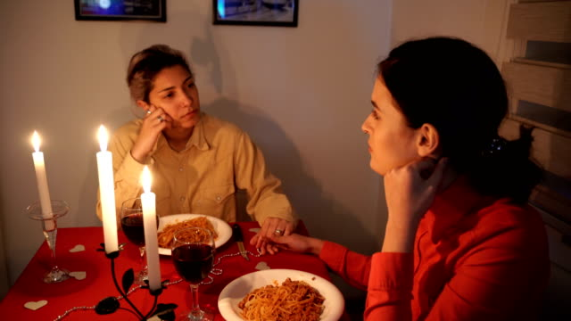 young lesbian couple on romantic diner - cinemanis videography stock videos & royalty-free footage