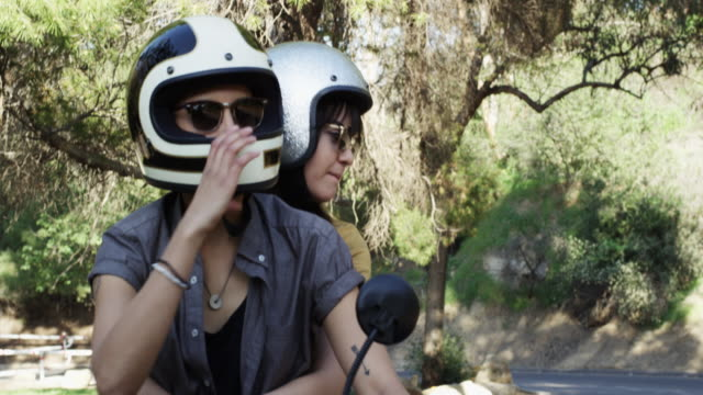 young lgbt girlfriends going around with a moped - 2 lesben stock-videos und b-roll-filmmaterial