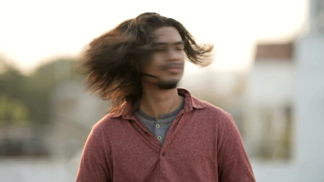 young long hair man shaking head. - windswept stock videos & royalty-free footage