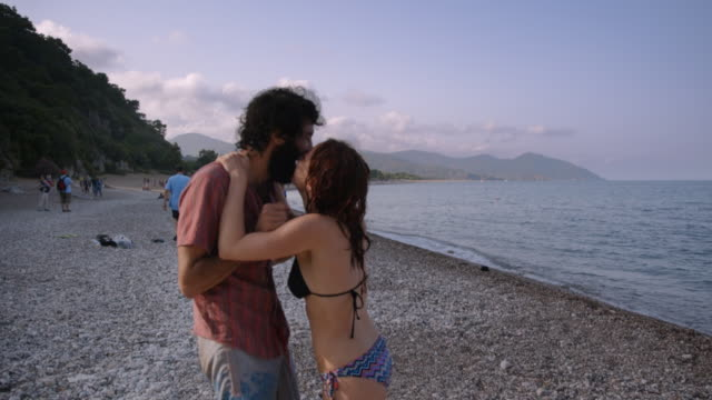 young lovers kiss on beach - Olympos, Turkey