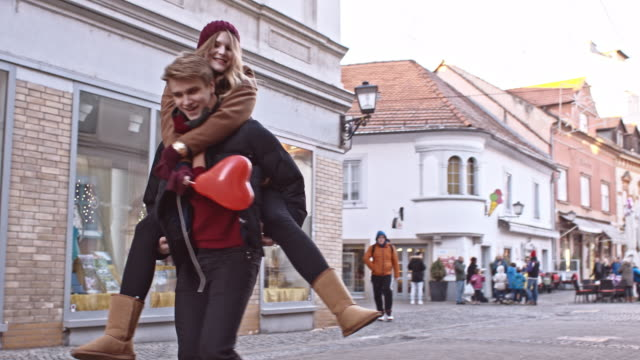 slo mo young loving couple in the city - piggyback stock videos & royalty-free footage
