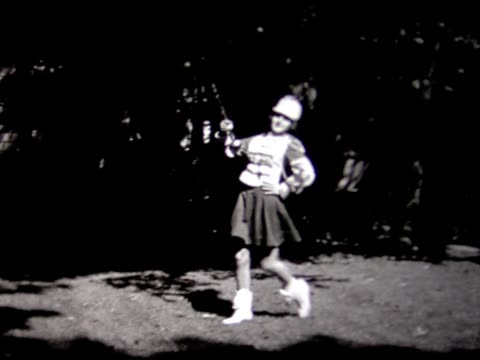 1948 young majorette practices in back yard - marching band stock videos & royalty-free footage