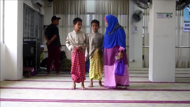 Young Malaysian boys take part in a mass circumcision ceremony at the Bandar Tun Hussein Onn mosque in Kuala Lumpur amidst grand welcome and...