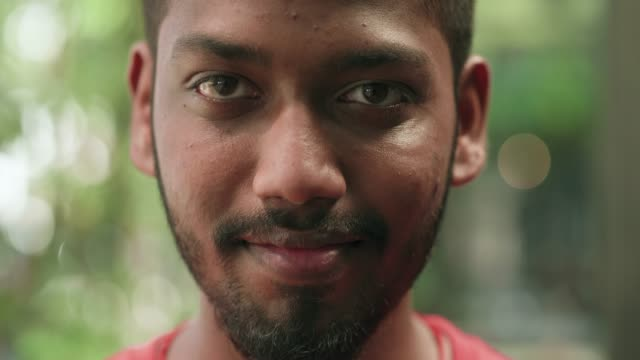 young malaysian man looking right at the camera - close to stock videos & royalty-free footage