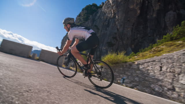 young male athlete cycling on a mountain pass - racing bicycle stock videos & royalty-free footage