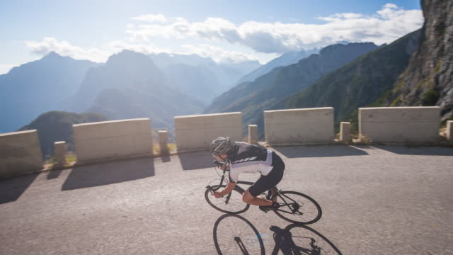 young male athlete road cycling on a mountain pass - racing bicycle stock videos & royalty-free footage