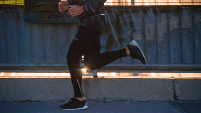 Young male athlete running in the city