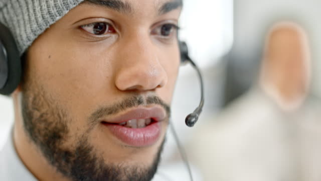 TU Young male call center operator talking to the customer