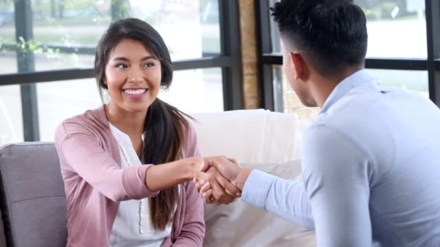 young male counselor and female patient share handshake. - psychiatrist's couch stock videos & royalty-free footage