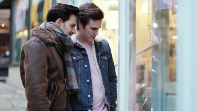 young male couple window shopping - window shopping stock videos & royalty-free footage