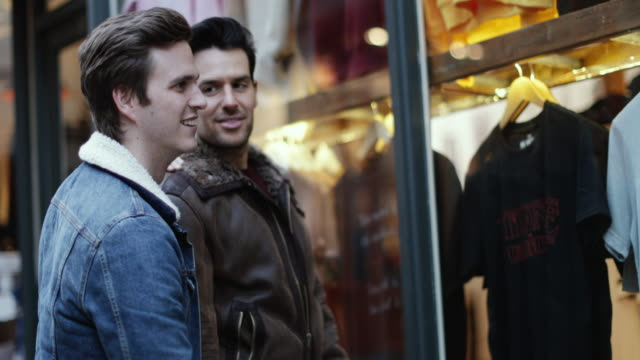 young male couple window shopping - window display stock videos and b-roll footage
