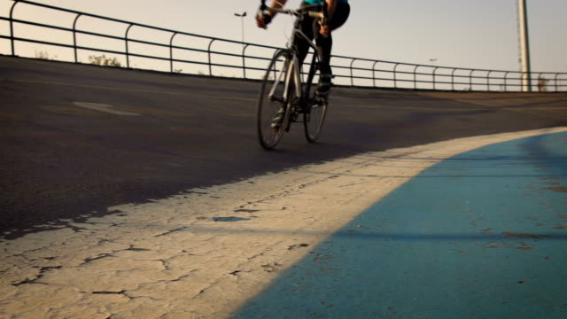 young male cyclist cycling on track outdoors - concentration video stock e b–roll