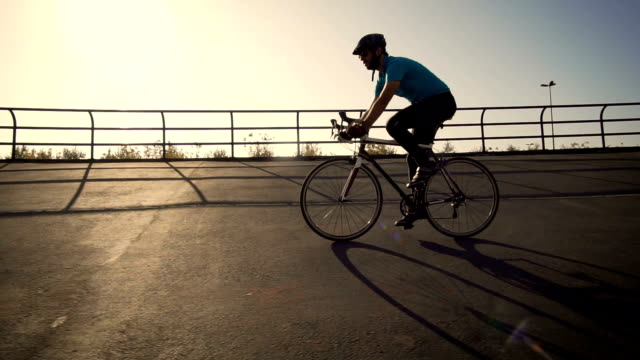 young male cyclist cycling on track outdoors - racing bicycle stock videos & royalty-free footage
