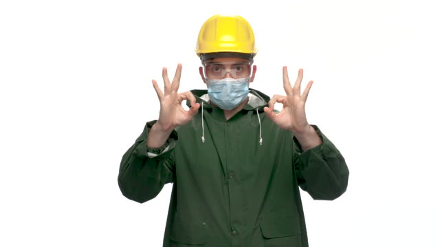 young male engineer looking at camera and show thumbs up sign, white background - stereotypically working class stock videos & royalty-free footage