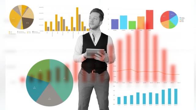 vídeos de stock, filmes e b-roll de young male entrepreneur using tablet computer thinking about investment idea strategy. virtual business charts background - manipulação digital