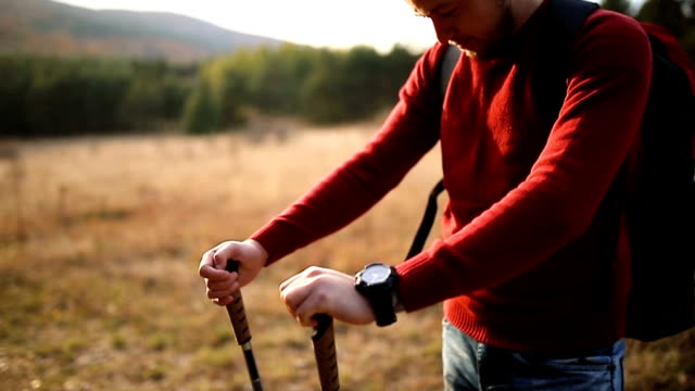 young male hiker with trekking poles - hiking pole stock videos & royalty-free footage