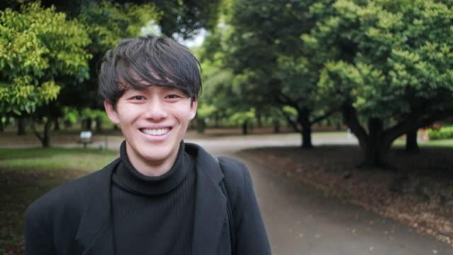 young male japanese adult at tokyo park - turtleneck stock videos & royalty-free footage