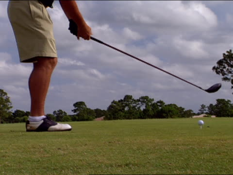 cu young male legs amp feet wearing golf shoes pan ms young male legs amp feet making practice putts adjusting gloves on hands la behind male driving... - golf glove stock videos and b-roll footage