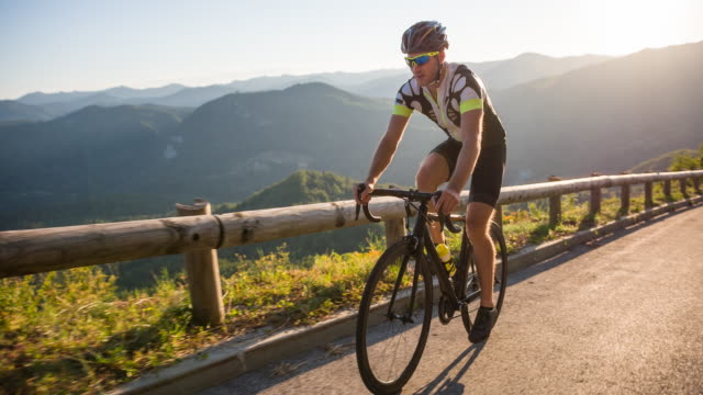 young male professional road cyclist during bicycle racing - racing bicycle stock videos and b-roll footage