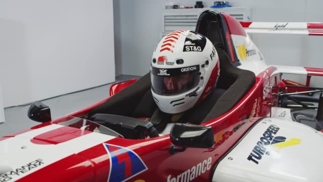 young male racer sitting in red racing vehicle - crash helmet stock videos & royalty-free footage