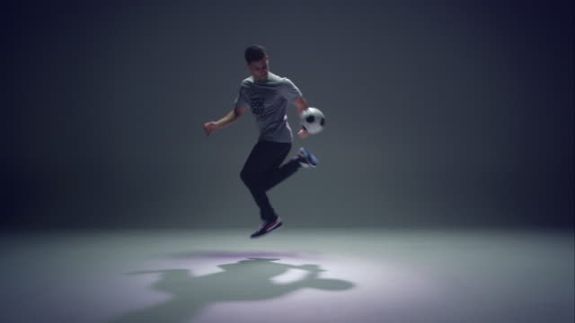 young male soccer freestyler is doing a crazy trick - stunt stock videos & royalty-free footage