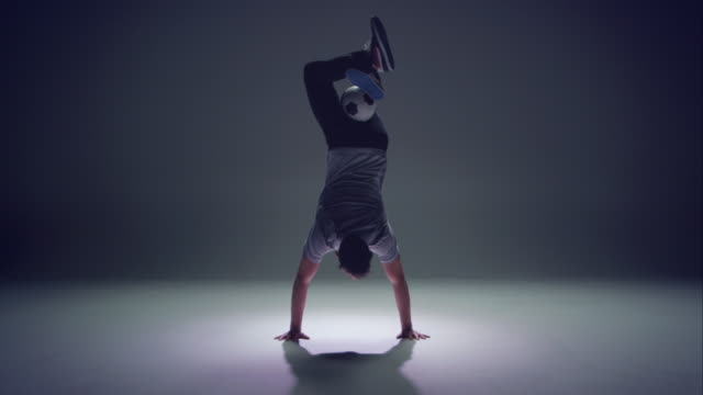 young male soccer freestyler is doing a handstand. - juggling stock videos & royalty-free footage