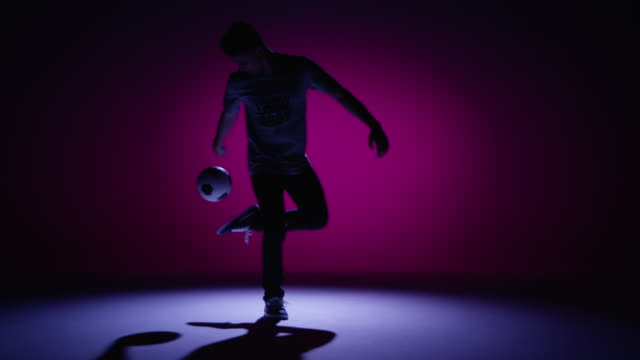 young male soccer freestyler is kicking up a ball - juggling stock videos & royalty-free footage