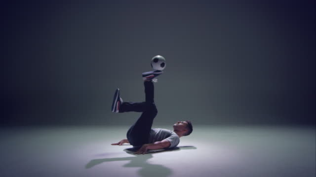 young male soccer freestyler juggling a ball on his brines - juggling stock videos & royalty-free footage