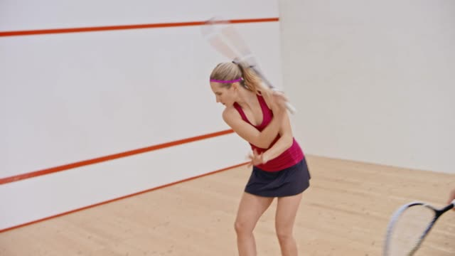 young male squash coach teaching a female student - squash sport stock videos & royalty-free footage