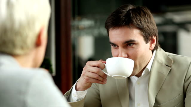 young man and woman drinking coffee - hoozone stock videos and b-roll footage