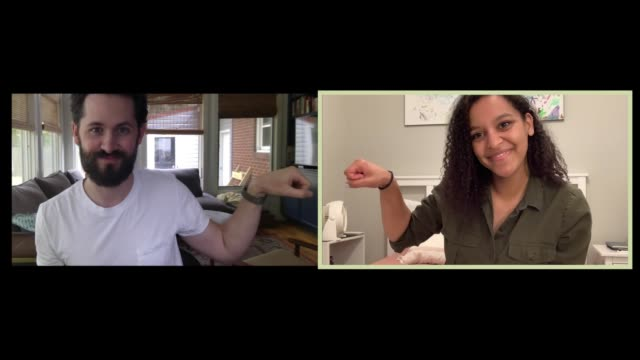 a young man and woman fist bump during a conference call - boyfriend stock videos & royalty-free footage