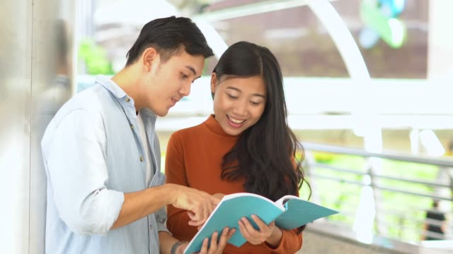 Young Man and woman read a book