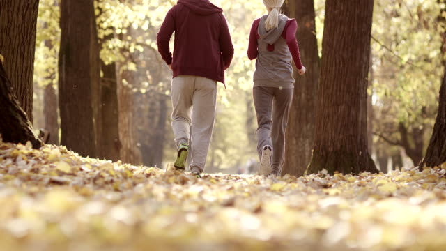Young man and woman running in the park